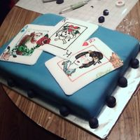 Ed Hardy Cake Ed Hardy Birthday Cake. Sheet cake covered in a custom colored Turqouise Blue Fondant and Giant Fondant Playing Cards with Ed Hardy designs...