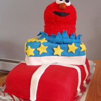 "Elmo Present Cake 9x13 chocolate cake ""wrapped"" in red fondant and white fondant ribbon. Next is a yellow 9x9 cake ""wrapped"" in blue..."