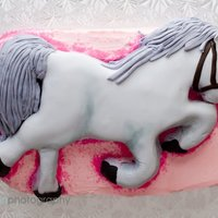 Gray Horse Pink layer cake with a gray horse on top.