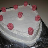 Heart & Roses Here's a cake that I made for a church lunch on valentines. I cant remember what the name of the roses are called at this time -...