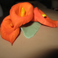 Orange Calla Lillies Gumpaste/Fondant Calla lillies on chocolate cake covered with chocolate BC & fondant. The Calla's were made after watching Edna&#...