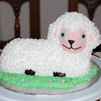 Lamb Fondant face and hooves. Buttercream wool.