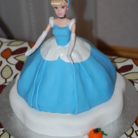 Cinderella Cinderella cake made for a girl's 4th birthday. The dress and accessories are made out of fondant.