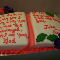 Bible Cake Bible cake covered in fondant with buttercream icing. Roses are made from fondant.