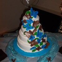 Butterfly Theme Wedding Cake Four tiered butterfly theme wedding cake. Each tier has individual flavors from milk chocolate, french vanilla, strawberry and marble....