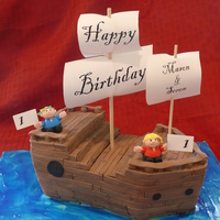 Pirate Cousins This cake was made for 1 year old cousins who were born hours apart. Ship is covered in fondant boards, characters are fondant, flags are...