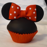 Minnie Mouse Cupcakes CHocolate cupcakes, covered with fondant, mounded buttercream underneath/ fondant bows and ears
