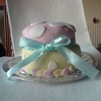 Polka Dot Pink And Yellow Cake Made for an 8th birthday x All decoration made of fondant icing finished with a silk blue ribbon
