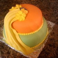 Anniversary 6 and 8 inch vanilla cakes with orange buttercream icing and fondant