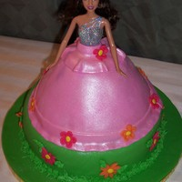 "Pink Barbie Princess I made this cake as a gift for a little girl's 5th birthday. The doll skirt is chocolate cake and the 10"" round is vanilla. The..."