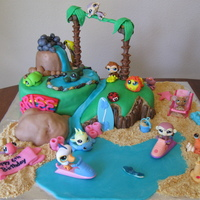 Beach Fun Island Beach Fun cake I made for my daughter's 6th b-day. All of the LPS animals are not edible, except for the alligator, turtle,...