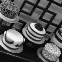 Black And White Table Cakes These cakes were done as a donation for the Ronald McDonald House Gala. Each cake was the centerpiece/dessert cake for the tables. All done...