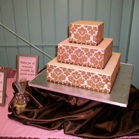 Pink And Brown Damask This is the first cake I've ever stenciled. I used it for a display cake at a craft show. Pink MMF and brown royal icing for the...