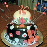 "Sweet 16 Whimisical Birthday Cake This cake was designed by the ""birthday girl"" who was very specific on what she wanted. She loves, roses, orange and black and..."