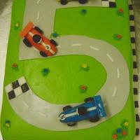 Birthday Cake This was a birthday cake that I made for my grandsons 5th birthday. Buttercream on cake, all cars made with fondant/gumpaste. My grandson...
