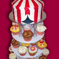 "Circus Of Fun 8"" vanilla Circus Tent Topper covered in fondant stripes... 40 circus themed cupcakes. Clowns heads are from Wilton & some sugar..."