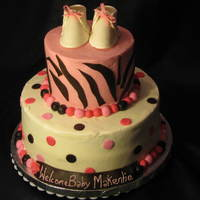2 Tier Baby Shower Cake  Baby Shower Cake, covered in Sugarshack Buttercream, Fondant circles, zebra stripes, balls. Gumpaste Baby booties. This is my first Baby...