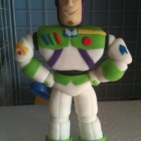 Buzz Lightyear To Infinity... And Beyond!!!! This is a solid fondant Buzz Lightyear I made for a Toy Story bed cake. Cake will be done Friday night. Will upload the final product then...