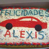 Ok, This Was The Final Cake, The Kid Loved The Car In It!! After practicing..I just prayed and went on to make this cake for the party. I was happy with it, to be the first oficial cake .. I think...