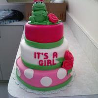 I'ts A Girl I made this cake for a friends babyshower. It took me a while to figure out how to make a frog cake for a girl but she loved how it came...