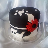 Black & White Deco This cake was inspired by the fabulous black & white cake done by Halfbake. This is 2, 2 layer, 8 inch cakes. Top is red velvet with...