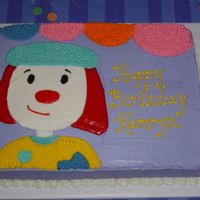 Birthday Circus Free-hand cartoon character; buttercream for most--with Frosting Doodle for the red hair and clown nose.