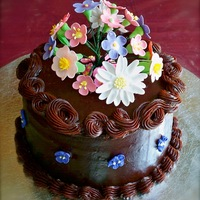 Mom's Chocolate And Flowers Cake   I made this small cake for my mom's birthday. It was my first time piping ganache. The flowers are gum paste.