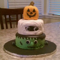 Halloween Cake  I took the idea from all of the wonderful cakes here on CC. It was easy and alot of fun to make. Good luck to everyone for this spooky cake...