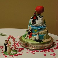 Round The World Before We Wed Groom's cake made in rich chocolate mud cake showing hand modelled scenes from the couples life before they wed including Oman, Angel...
