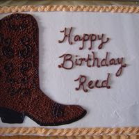 Cowboy Boot   Free-hand cowboy boot in chocolate with black accents; all buttercream