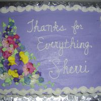 Floral Design Buttercream frostingwith royal flowers; reverse scroll and shell borders in buttercream