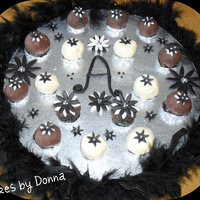 Black And White Cake Balls These are Cake Balls I made for a co-worker. Black and white themed. WASC cake with chocolate and vanilla coating. Flowers are MMF with...