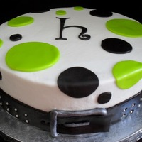 Green And Black Polka Dot Buckle Cake Wedding white cake with cream cheese filling. Buttercream frosting with fondant accents. Belt buckle brushed with silver dust.