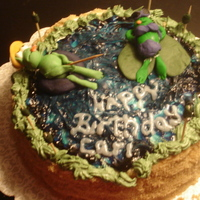 Frog Vacation Birthday Cake A girl at work loves frogs fishing and the color purple, so did a lemon cake with black cherry filling (her favorite flavors which tatse...