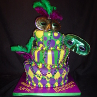 Mardi Gras Bar Mitzvah Cake   My special 'Quadruple Bypass Chocolate cake for a bar mitzvah Mardi gras themed party! gumpaste masks and real feathers