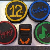 Rock Band Birthday This cake was for a 12 year old boy's birthday who likes Rock Band. The cakes are all buttercream. For the black I started with...