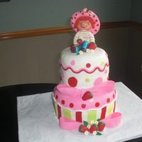 Strawberry Shortcake The doll is made completely out of white chocolate. Was given a picture from the client to match.