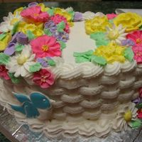 Course 2 Final   Butter cream frosting, royal frosting flowers. First time doing the basket weave.