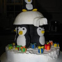 Penguins With An Igloo!  This was so fun to make! The igloo is fondant-covered yellow cake, and the bottom iceberg is buttercream covered chocolate cake. The...