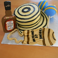 Colombian Cake sombrero vueltiao tipical hat from colombia qith a whisky bottle, a mochila and maracas