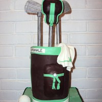 "Golf Bag 3 6"", covered in modeling chocolate, clubs are gumpaste, ball is RK covered in fondant.....thank you to all the past CC's for..."