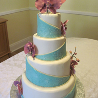 Paisley Orchid Wedding Cake Design inspired by Plant Cake's design. Teal and paisley pattern from the invitation, orchids made to match their centerpieces. Thanks...