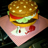 Cheeseburger   I made this cheeseburger for a cake walk at my son's school. The toppings and ketchup are made out of marshmello fondant.