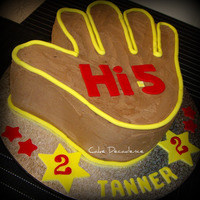 Hi 5 Giant Hand Cake This is a giant of a cake (it stands over 6 inches tal) - carved from 2 X 12 inch square rich chocolate mudcakes.Layered and coated with...