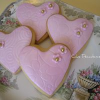 Fondant Covered Cookies Heart shaped sugar cookies covered with fondant and dusted with lustre dust.