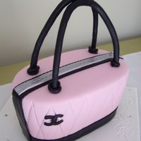 Chanel Handbag Cake Dark chocolate mudcake, torted and coated in dark chocolate ganache and covered in fondant. Taken from the Planet Cake book.