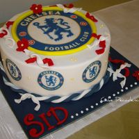 Chelsea Football Cake An 8 inch chocolate cherry ripe mudcake, layered and coated with dark chocolate ganache and covered in fondant for an avid Chelsea...