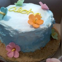 Aloha!!! One of my nieces teachers ordered this cakes. Hawiian themed fondant flowers and buttercream air brushed blue.