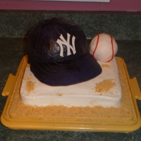 Yankee Baseball Cake In memory of my husband's grandpa, i true yankee fan. Hat is chocolate cake, base is yellow cake, brim is gumpaste, ball is krispy...