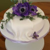 Anemone Cake Vanilla sponge with sugar anemone flower, ruscus and ivy topper.